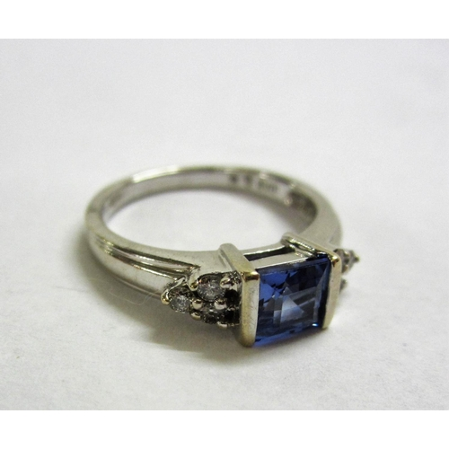 458 - Diamond & Blue Stone Ring, central blue stone with diamond clusters either side, set 9ct. White Gold...