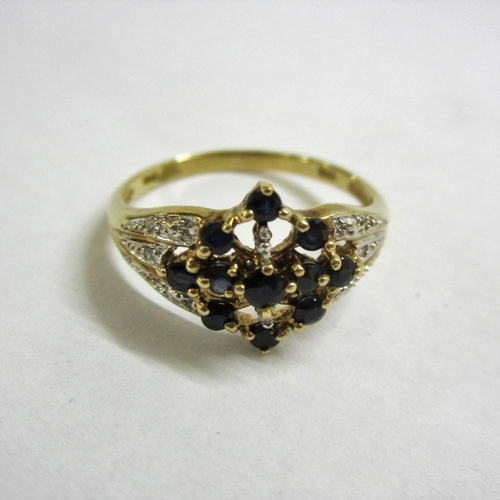455 - Sapphire & Diamond Cluster Ring set 9ct. gold size P...