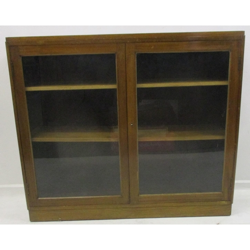23 - Blonde Walnut 2 Door Bookcase with pair open glazed doors, on plinth base...