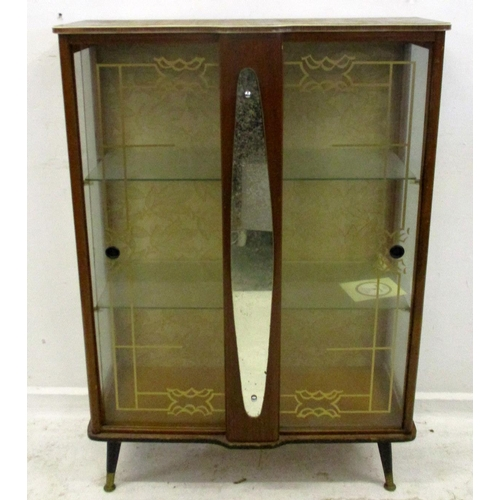 1A - 1970s Display Cabinet with stencilled glass sliding doors, glass shelves, on ebonised adjustable fee...