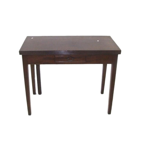 37 - Late C18th Mahogany Tea Table with flip-over top supported on swing leg, central frieze drawer, on r...