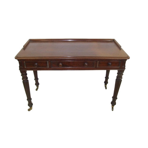 13 - William IV Mahogany Side Table on turned & carved supports with brass cup castors, mahogany lined fr...