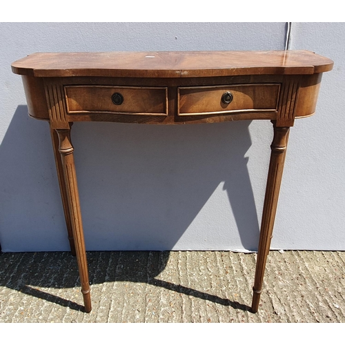 48 - Reproduction Hall Table with serpentine top, 2 frieze drawers with ring-pull handles, on circular fl...