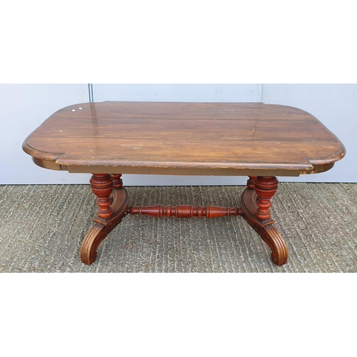 24 - Coffee Table with turned centre stretcher, on scroll feet (A2/3B)...