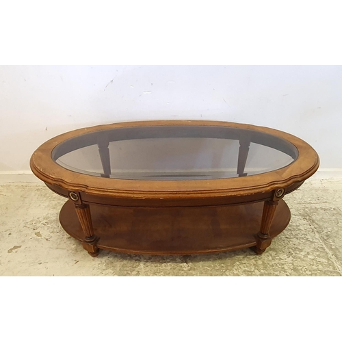 58 - Oval Glass Topped Coffee Table with under tier (A2/3F)...