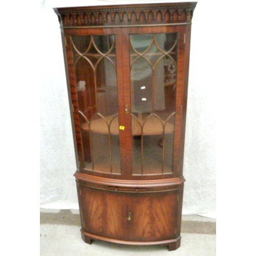 6 - Large Mahogany Standing Corner Cabinet with 2 flame mahogany doors, on bracket supports, arched glaz...