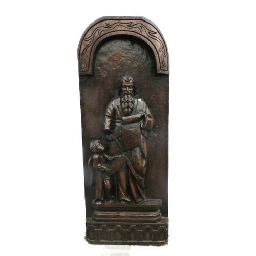 18 - Large Carved Oak Deep Relief Panel St Matthew holding scroll with attendant angel, on plinth base, a...