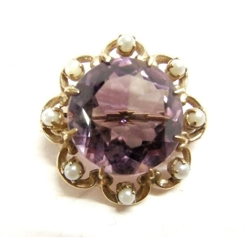 49 - 9ct. Gold Amethyst & Seed Pearl Brooch, central large amethyst with petal style boarder inset with s...