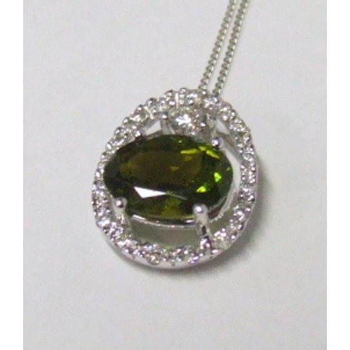 114 - 18ct. Gold Tourmaline & Diamond Pendant on chain/necklace, oval tourmaline suspended within a diamon...
