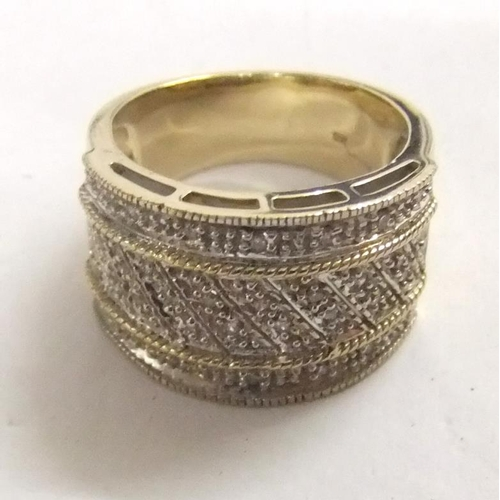 153 - 9ct. Gold Wide Band Diamond Ring size O...