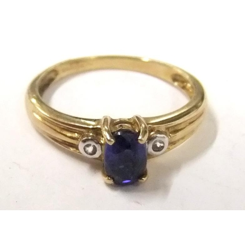 154 - 9ct. Gold Burmese Sapphire & Diamond Ring size N, central oval sapphire with diamond points either s...