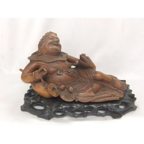 660 - Chinese Hardwood Carving Jolly Buddha reclining with frog, cache on his right hand, on carved hardwo...