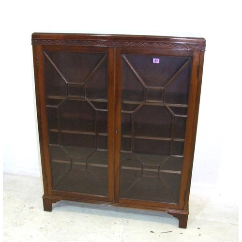10 - Mahogany 2 Door Bookcase with blind fret carved caddy top, on bracket supports, pair glazed doors wi...