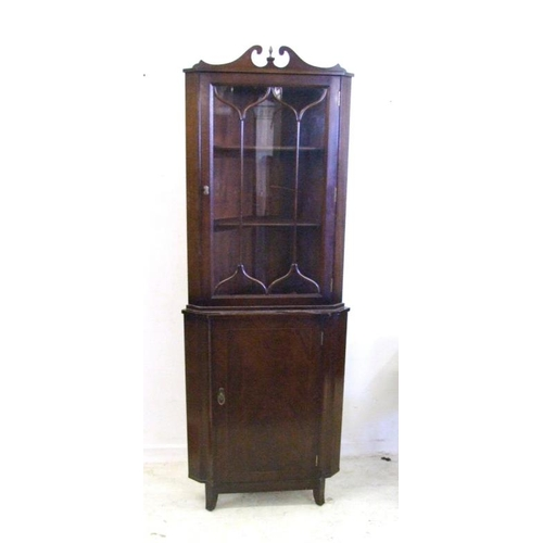 12 - Flat Fronted Corner Cabinet on kicked-out square section supports, superstructure with tall glazing ...