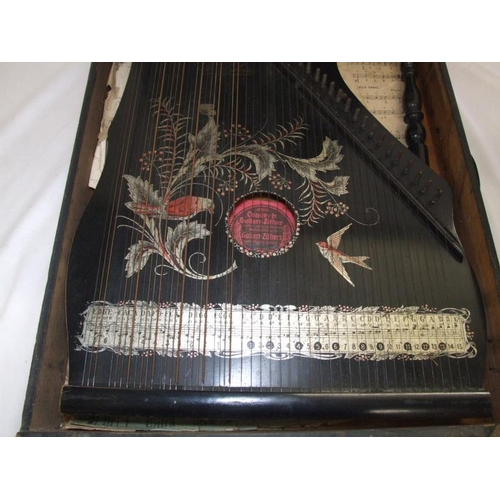 797 - Guitar Zither decorated with birds & leaves, in fitted case with hinged cover...