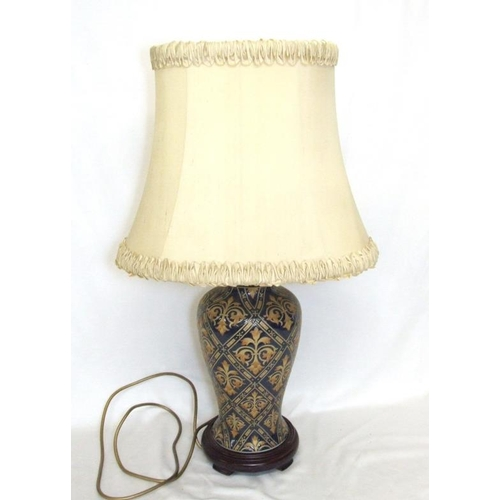 829 - Baluster Shaped Table Lamp on turned wooden base with cream shade...