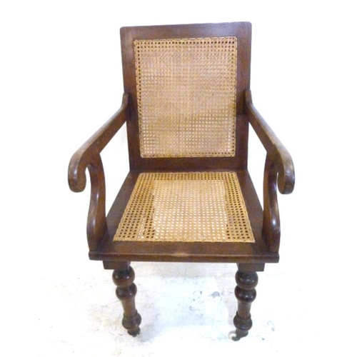 55 - Rattan Armchair with caned back panel, on turned supports with castors (A5)...