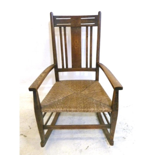 59 - Country Rocking Chair with straw seat, Arts & Crafts style supports, centre splat with small inlay (...