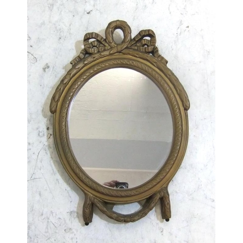 72 - Oval Gilt Framed Strut Mirror with ribbon & bow decoration (A3)...