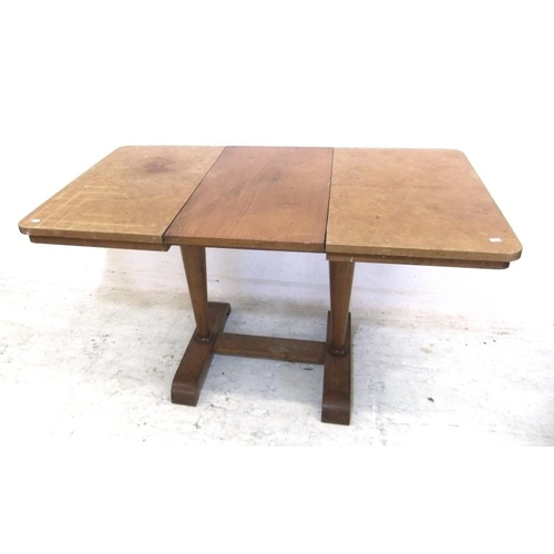 84 - Heals? Blonde Wood Draw Leaf Table with integral leaf, on ski style supports, quarter veneered top (...