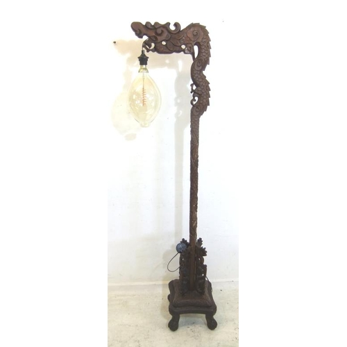 85 - Chinese/Oriental Standard Lamp on 4 scroll supports, carved stem with 4 fretted wings, dragon head t...
