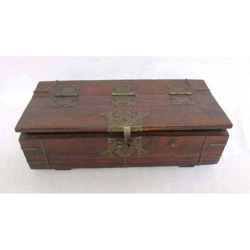 651 - Japanese Box with hinged cover, brass mounts, lined with oriental script, marked Somerton Deal Kent...