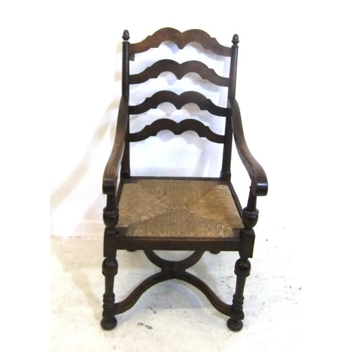 179 - Oak Ladder Back Carver Chair with woven straw seat on Queen Anne style turned supports, acorn finial...