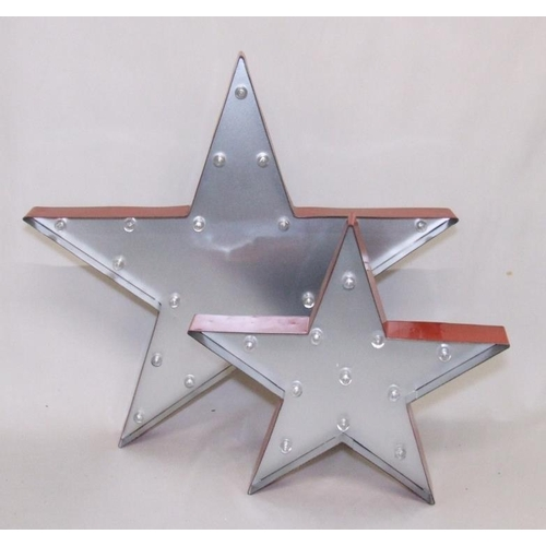 946 - 2 Metal Illuminated Stars, battery powered, largest approx. 21