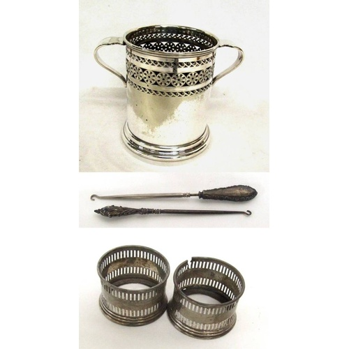 556 - Silver Plated Siphon Holder with pierced decoration, 2 Silver Napkin Rings & 2 Silver Handled Button...