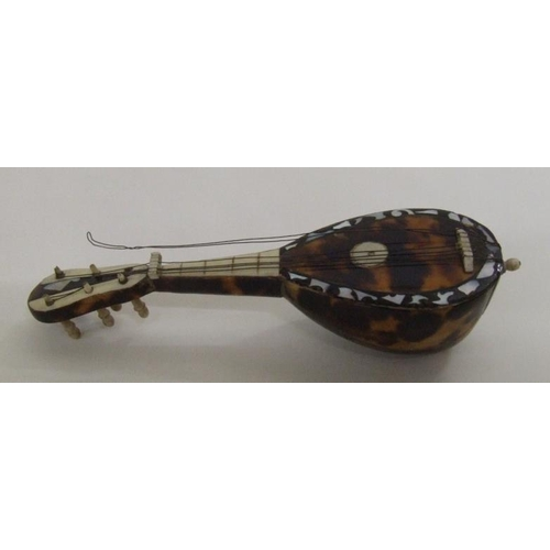 666A - Miniature Tortoiseshell Lute? with nickel stringing...