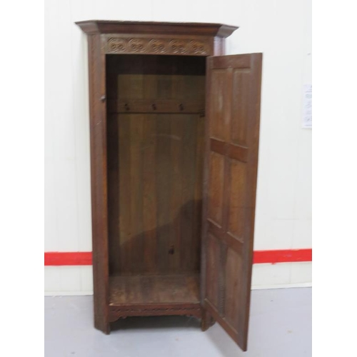 24 - Oak Hall Robe with canted corners, plain cornice, panelled door, decorative carved frieze (A13)...