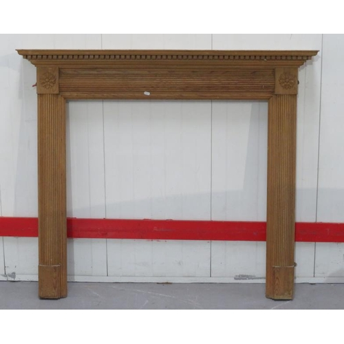 25 - Modern Pine Fire Surround with mantel shelf, reeded supports with flower head terminals (FWR)...