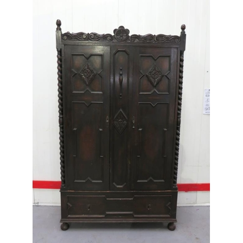 23 - Heavy Continental Carved Oak 2 Door Wardrobe with geometric panels under decorative cornice, turned ...