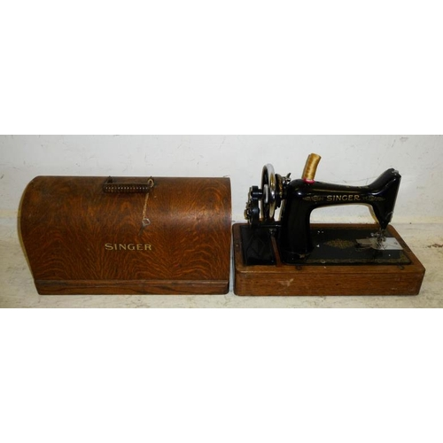 1A - Singer Hand Sewing Machine, black enamelled body with gilt transfers, domed cover with key (A1)...
