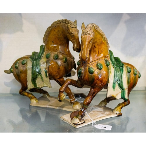30 - A pair of Chinese sancai glazed pottery horses: in Tang Dynasty style, each with long saddle cloth a...