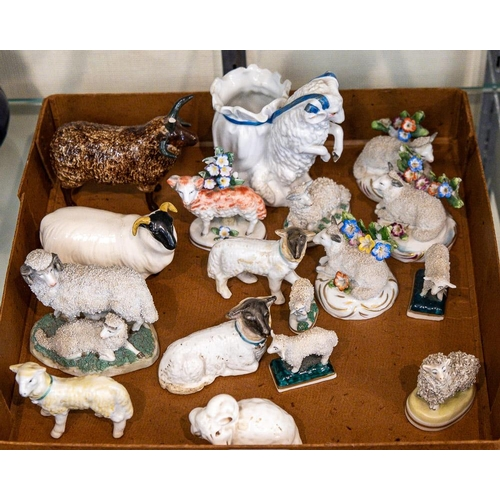 35 - A group of predominently Continental hard paste small models of sheep: including two Beswick and one...