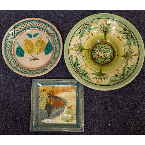36 - A Studio pottery dish of square form,: the centre decorated with a bowl of fruit, together with a sh...