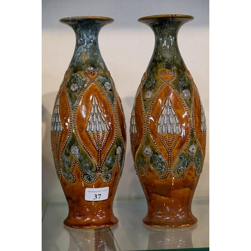 37 - A pair of Doulton stoneware vases,one with repair to rim.:
