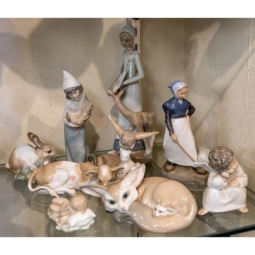 42 - Nine various Lladro figures including 'Goose Girl', 'Desert Fox', 'Rabbit' etc. (9):