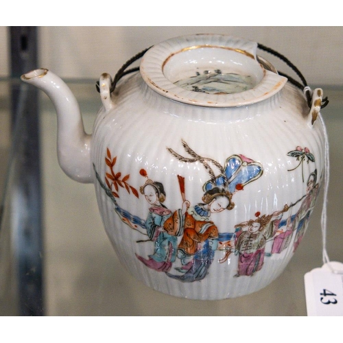 43 - A Chinese famille rose teapot and cover: of circular reeded form, with metal double loop handle, pai...