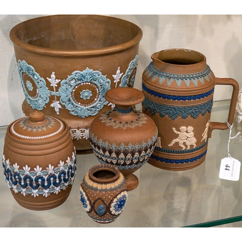 44 - A group of Doulton silicon ware: - jardiniere, biscuit barrel, jug and vase.