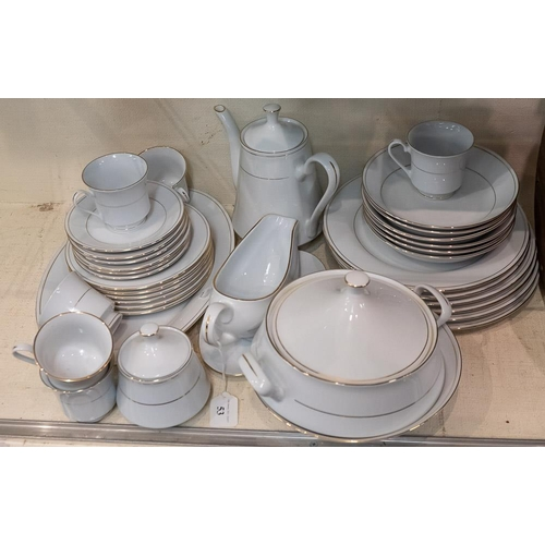 53 - A Crown Ming porcelain dinner and tea service of plain design with gold edging.: