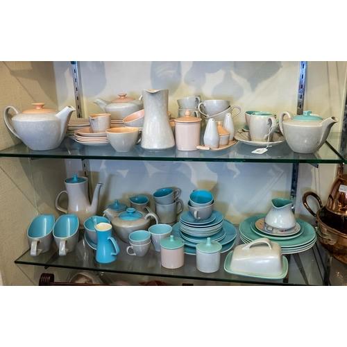 56 - Three Poole pottery duo tone teasets: etc.
