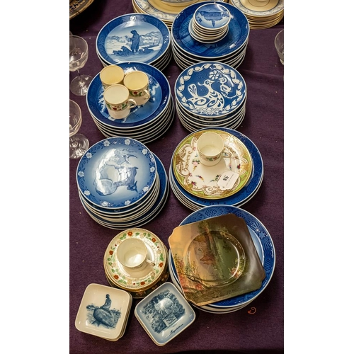 58 - A collection of Royal Copenhagen Christmas plates and souvenir plates:, a Royal Doulton series ware ...