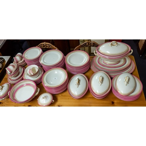 61 - A Royal Worcester pink banded dinner service:, to include soup tureen and stand, dinner plates, side...
