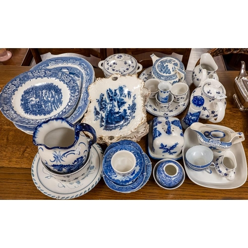 62 - A group of Willow pattern and other blue and white ceramics includes Royal Doulton Yorktown dinnerwa...
