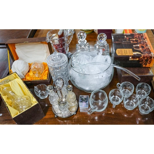 9 - Miscellaneous glassware : including a group of glass decanters and a glass punch set.