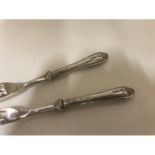 40 - Pair Hall Marked Silver Pickle forks c1922...
