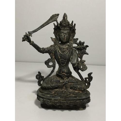 18 - Oriental cast bronze figure of a seated deity. approx 20cm tall...