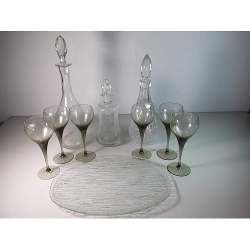 56 - 3  Glass decanters and 6 glasses...